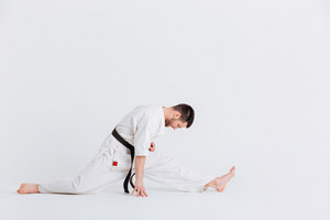 Man in kimono doing stretching exercises