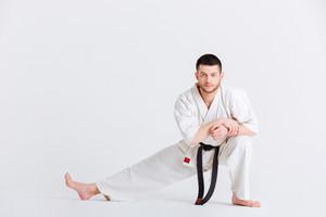 Man in kimono preparing for fighting