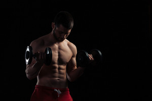 Handsome man workout with dumbbells