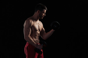 Muscular man workout with dumbbells