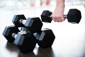 Two pairs of metal dumbbells on the floor