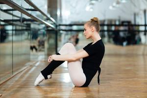 Ballerina resting on the floor