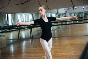 Woman dancing in ballet class