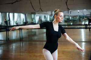 Attractive woman dancing in ballet class
