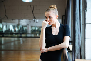 Relaxed woman standing in ballet class