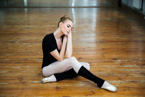 Ballerina relaxing on the floor
