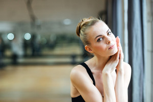 Ballerina resting in ballet class
