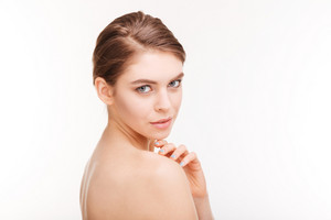 Woman with fresh skin looking at camera
