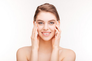 Happy woman with skincare