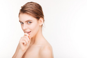 Beautiful woman with fresh skin looking at camera