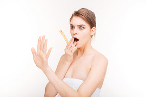 Shocked young woman with emery board looking at her nails