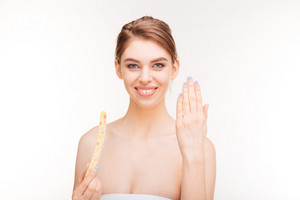 Happy young woman with nail file showing her nails