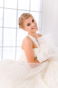 Happy bride standing in white wedding dress