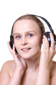 Portrait of an attractive enigmatic  blue-eyes girl with headphones