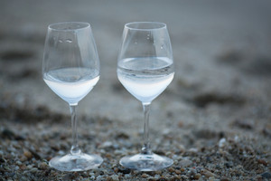 Two glasses of water on the beach