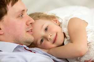 Lovely girl close to beloved father