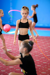 Girls exercising during gymnastics class