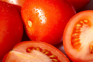 Fresh red tomatoes with water drops