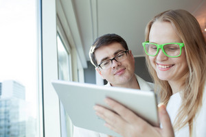 People wearing glasses with tablet pc