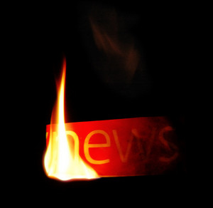 Hot news. newspaper fire text.