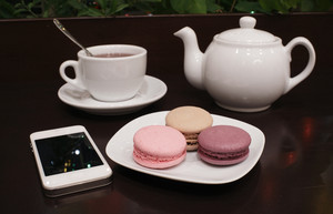 Tea and macaroons with a tablet computer