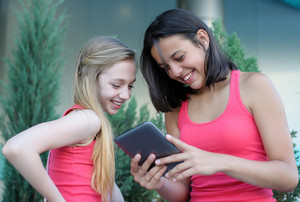 Two teen girls with tablet pc
