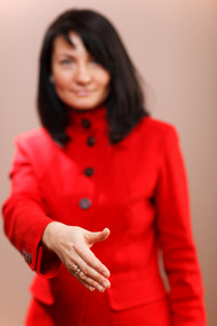 Woman offering her hand in a handshake