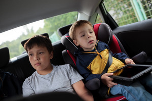Children sitting in the car and looking at road