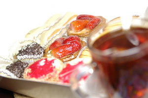 Cup of tea and diversity of french pastry with cream