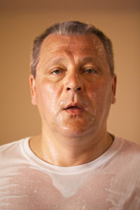 Tired looking middle-aged man after a workout