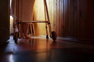 Senior woman using walker at home