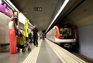 Passengers wait for the train