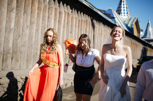 Bride and her bridesmaid walking with friends