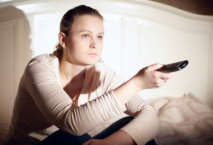 Young woman is watching tv