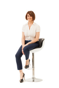 Portrait of smiling businesswoman on chair