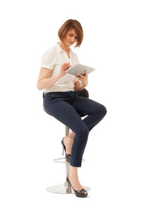 Businesswoman using tablet while sitting on chair