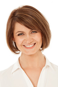 Cheerful adult woman smiling at camera