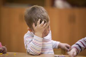 Cute little child in kindergarten class