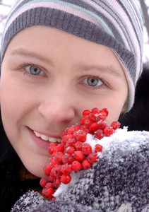 Young girl holding mountain ash berries