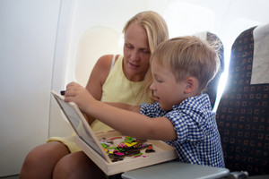Mother and son playing together in the plane