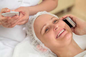 Woman having a phone talk at beauty spa