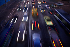 Car traffic at night  motion blurred background
