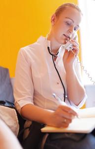Nurse is speaking on the phone