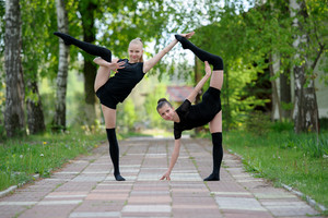Young gymnast girls posing outdoor