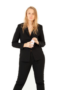 Businesswoman looking at camera while holding smartphone