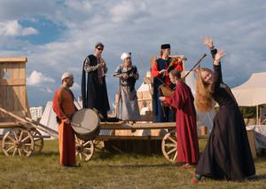 Folk musicians and woman dancer