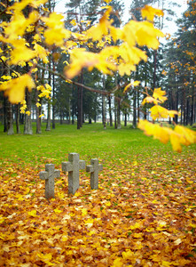Three tombstone crosses