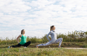 Two young girls exercising outdoors