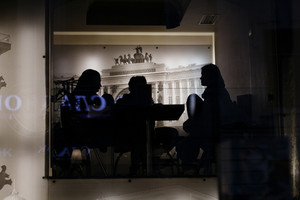 Silhouettes of people in the cafe