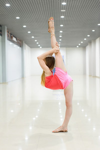 Young girl stretching out indoor